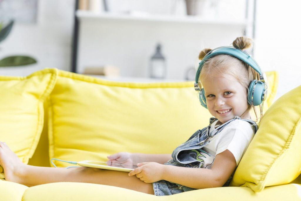 Child listening to song on headphones