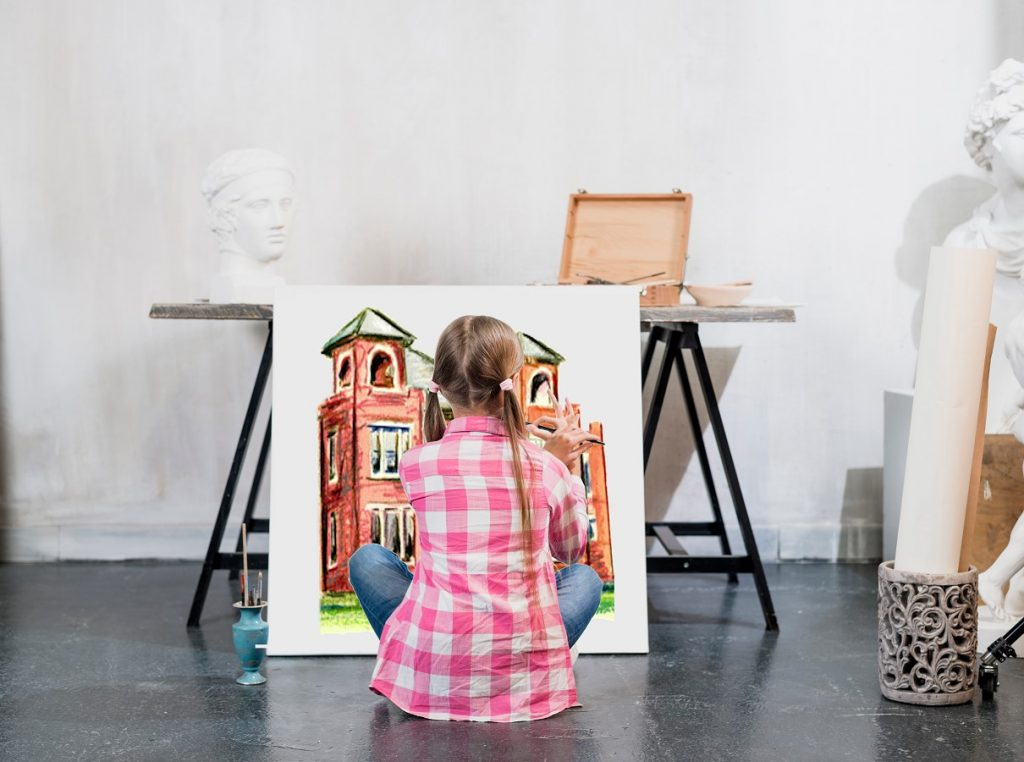 Girl painting school in a art studio